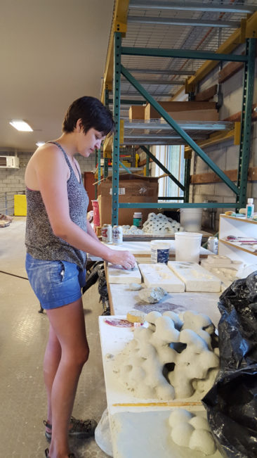 2017 resident Madeline Walker working on her ceramic sculpture
