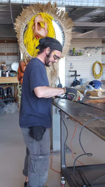2017 resident Miguel Guzman working on his Burning Man sculpture